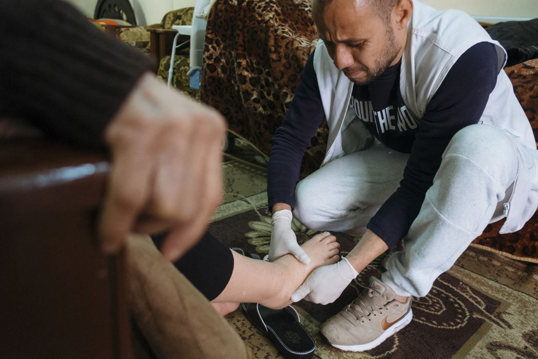 "In the Burj el-Barajneh Palestinian camp to the south of Beirut, an MSF team provides home-based care to almost 170 elderly and bed-ridden patients living with chronic diseases. The service brings not only medical benefits for the patients, but often also allows a brief moment of human warmth in otherwise very lonely lives. ""When they visit me I feel better. They visit me two or three times a week. I tell them that I'm out of my medication and they get it for me,"" says Amina Banat. Photographer: Bruno De Cock"