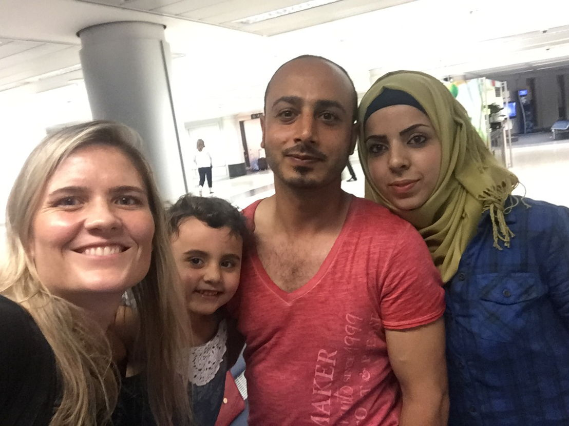 Journalist Sophie McNeill with Khaled and his family