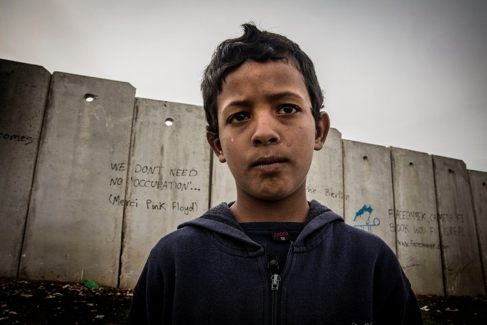 MSF Photos of 2015<br/>System identifier<br/>: MSF150048<br/>Title<br/>: Occupied Minds_ Mustafa Suliman<br/>Photographer / cameraman<br/>: Surinyach Anna<br/>Countries:<br/>Palestinian Territories. Mustafa is only 11 years old but he has already been detained for interrogation. He lives in a makeshift shed with 21 other people from his extended family. He has seven siblings and his parents live in Jericho, one hour drive away with their sheep, where he goes on the weekends. He likes math and Arabic besides science and would like to work with his father in a supermarket and looking after the sheep.<br/>Mustafa is only 11 years old but he has already been detained for interrogation. He lives in a makeshift shed with 21 other people from his extended family. He has seven siblings and his parents live in Jericho, one hour drive away with their sheep, where he goes on the weekends. He likes math and Arabic besides science and would like to work with his father in a supermarket and looking after the sheep.