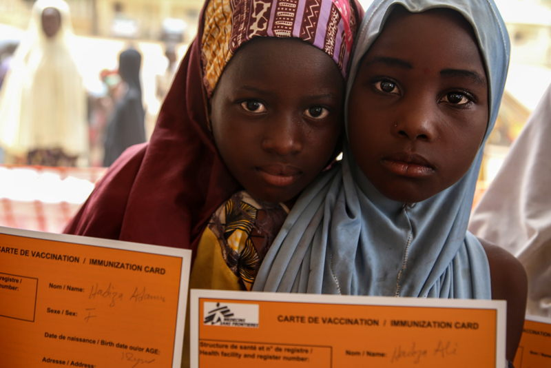 Two girls hold their MSF vaccination cards in Damaturu town, in the north-eastern Nigerian state of Yobe. Photographer: Igor Barbero/MSF