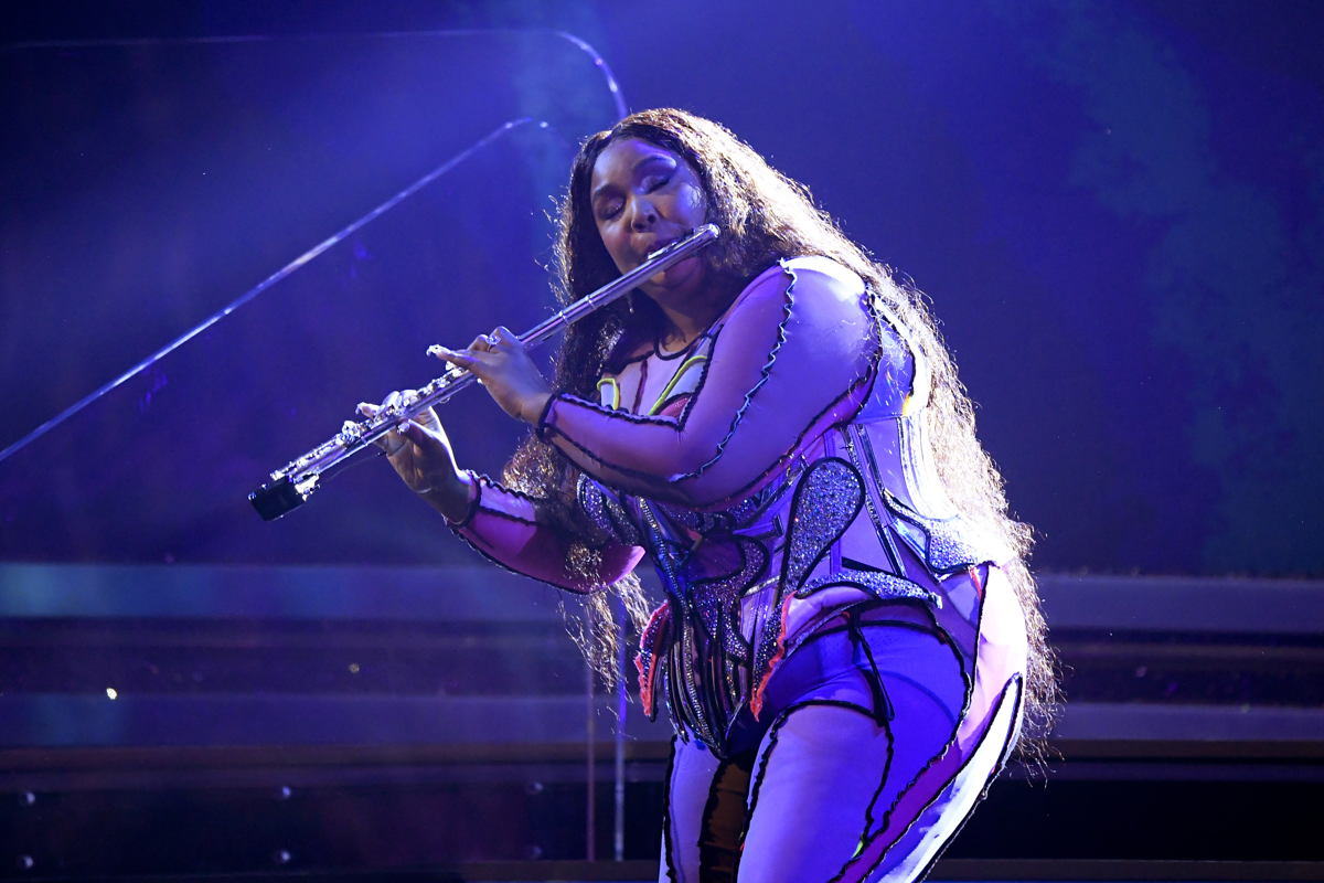 Lizzo performing at the 62nd GRAMMY Awards in Los Angeles, California (Photo credit: Getty Images/Kevork Djansezian)