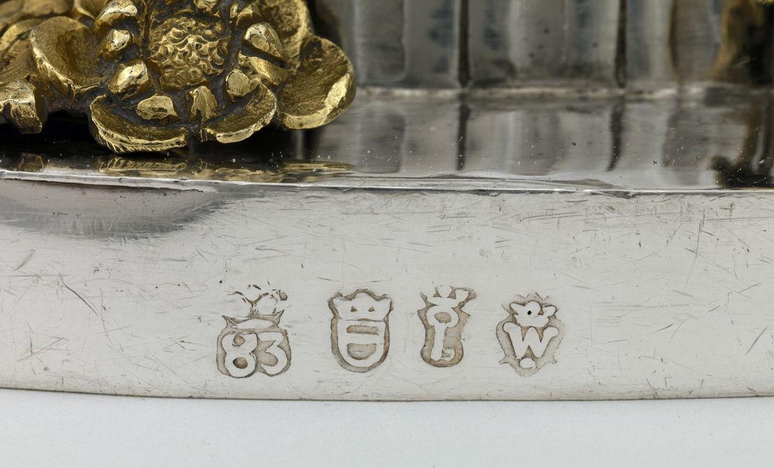 Detail van een Leuvens keurmerk