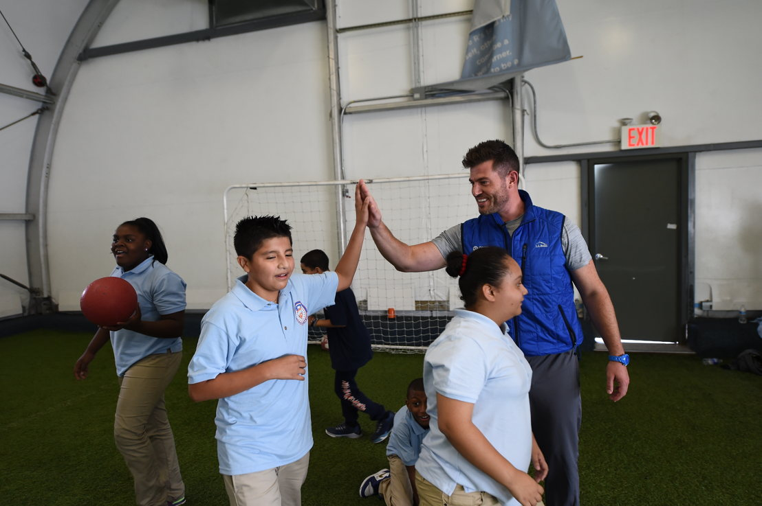 Jesse Palmer and Good Sports met in NYC where a sixth-grade PE class was presented with much-needed equipment.