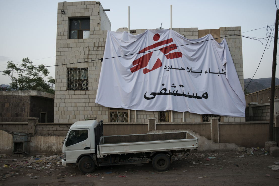 An MSF flag hangs on one of MSF's facilities in Qataba, Al Dhale governorate. Airstrikes and ground shelling have hit civilian facilities in the past, and MSF demarcates all their facilities and vehicles to keep staff and patients safe. Yemen, July, 2014. Credit MSF
