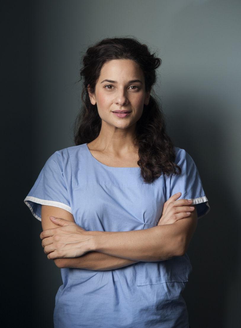 Andrea Demetriades as Lou Tanner