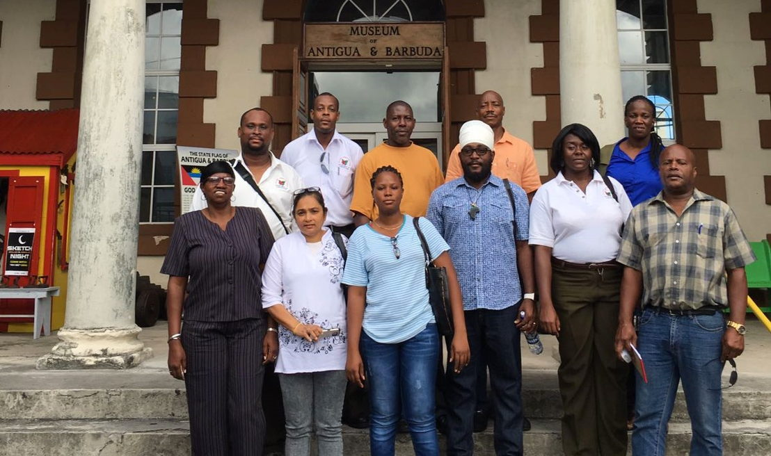 Training participants stand for a photograph outside of the Antigua and Barbuda Museum