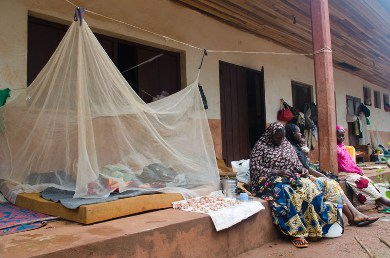 """Around 2000 Muslim people sought refuge on the Church site when the Muslim neighbourhood, Tokoyo, was attacked on May 13th 2017. They cannot leave it for fear of being killed by """"auto-defense"""" groups in town. Water is provided by the church and food is sparse, randomly distributed by humanitarian actors. MSF organizes daily mobile clinics on the site to provide primary health care. Photographer: Natacha Buhler"""