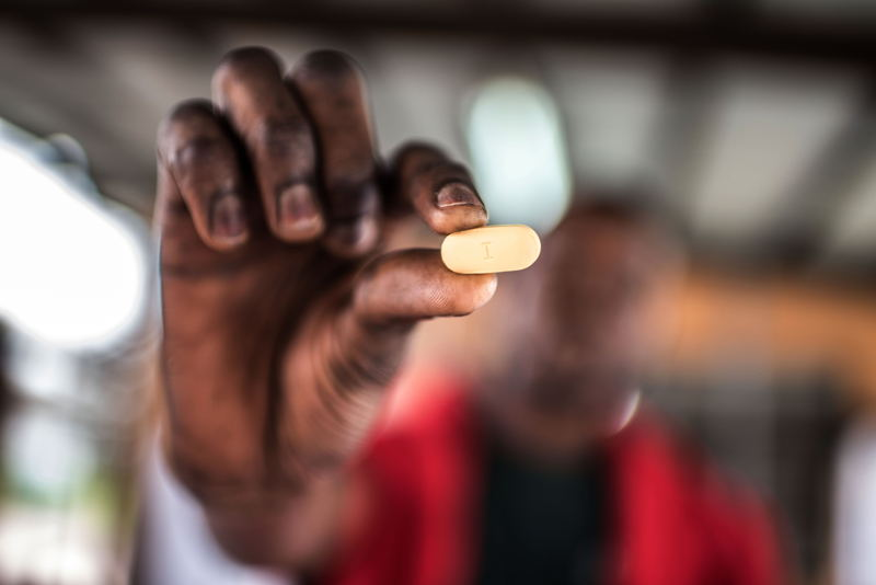 This man was kicked out of his house by his sister in law after being diagnosed wit HIV. He has been taking Antiretroviral drugs (ARVs), which he collects from the Kabinda Hospital, and has almost recovered sufficiently to restart his work. Photographer: Tommy Trenchard