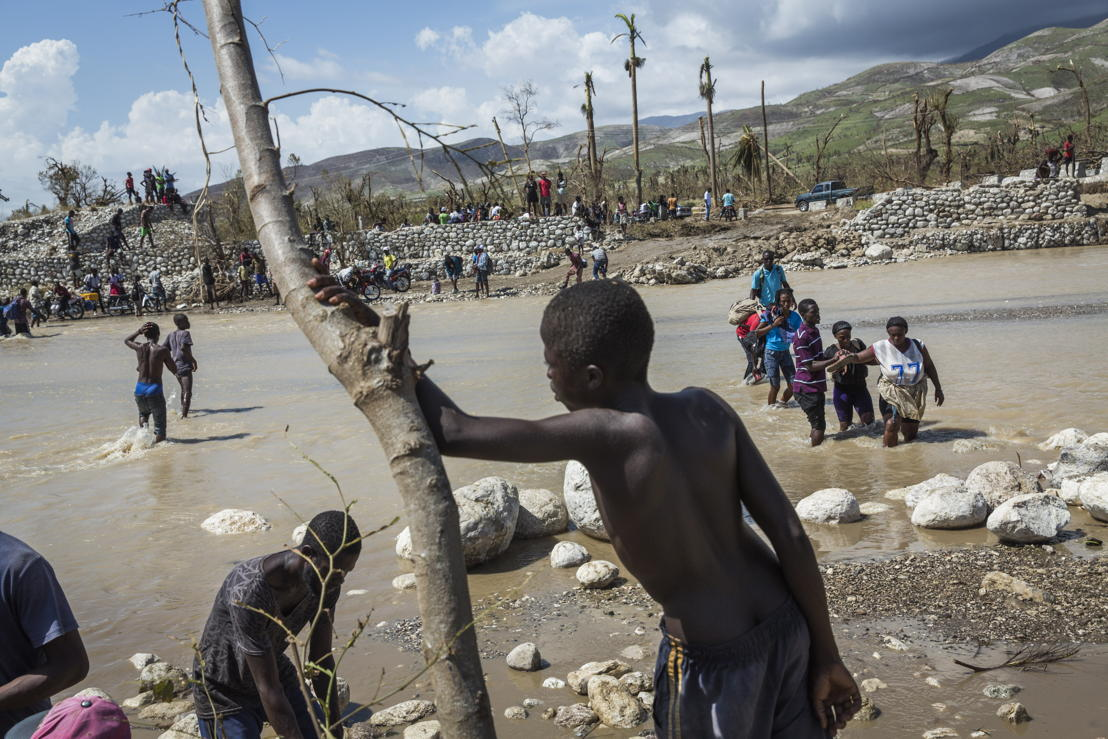 A collapsed bridge at Roche-a-Bateau means people must cross through the river on foot, in southwestern Haiti. Hurricane Matthew tore through the Caribbean on October 4 and devastated large parts of the island. Photographer: Andrew McConnell/Panos Pictures