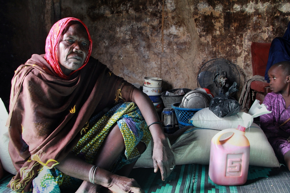 Hauwa Abba, 55, was forced to flee her home in Abadan two years ago following an attack, and has been living in a camp in Maiduguri with her family ever since. They were one of 500 families to receive a food distribution from MSF on December 14, 2016. Photographer: Malik Samuel/MSF