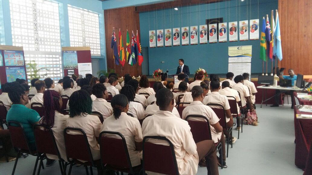 Students listen to a presentation at the ECSC 50th Anniversary Exhibition held in Saint Lucia