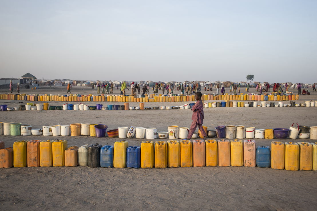 Every morning the camp residents rush to the water point to line up their buckets to be filled. Access to water is a major problem for the displaced. Photographer: Sylvain Cherkaoui
