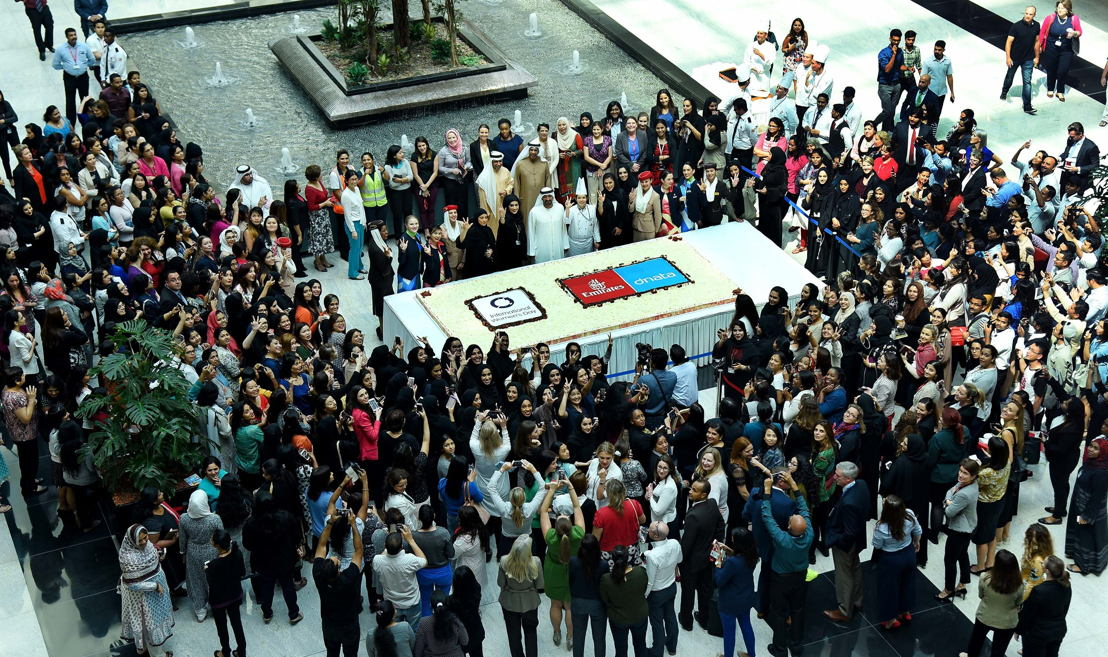 HH Sheikh Ahmed bin Saeed Al Maktoum, Chairman and Chief Executive, Emirates Airline and Group, celebrating International Women's Day surrounded by staff  at the Group's headquarters.