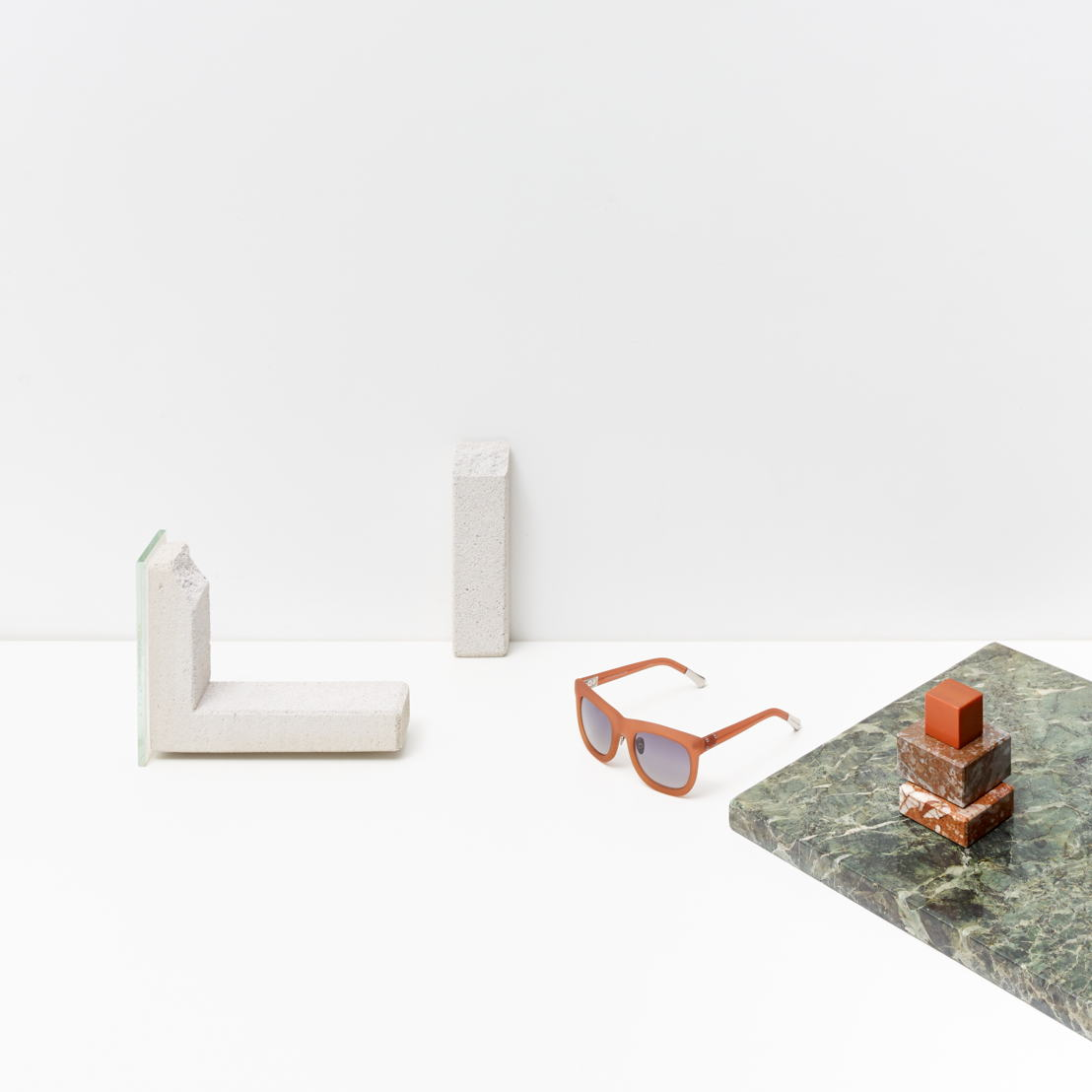 Kris Van Assche - Rubberised orange acetate frame teamed with a grey gradient lens