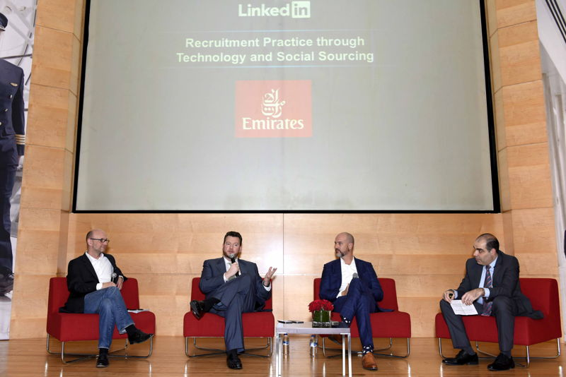 Recruitment professionals  speaking during a panel discussion on 'Enhancing the Candidate Experience Through Technology'.