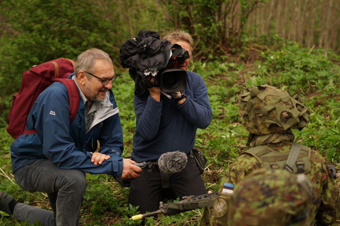Reporter Eric Campbell & cameraman Ron Ekkel with Estonian reservists during war games, Estonia