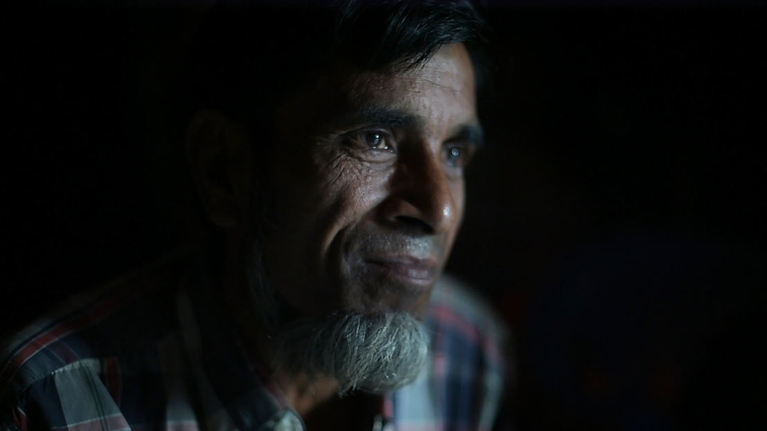 "Abu Ahmad: ""I always have so many worries; worries about the future.""<br/><br/>Abu Ahmad is a 52-year-old father of eight (four daughters and four sons). His 11-year-old daughter Rukia became paralysed shortly before the violence erupted in August 2017. After arriving in Bangladesh, Rukia spent over seven months at MSF's medical facility in Kutupalong. She returns to the facility every couple of days to have her bedsores treated. Here, Abu Ahmad recounts how the family fled, what life is like for his family in Bangladesh, and their hopes for the future.<br/><br/>""Before the conflict, we had cows, goats, land, all those things. Our business and livelihoods we earnt ourselves. But we faced lots of threats and torture from the government in Myanmar. If someone wanted to get higher education, that person would have to flee the country because if the government found out, they would arrest him. Our movements were very restricted; we were not allowed beyond the checkpoints. We could only move within our area. Other people, like monks and different [ethnic] communities, were free to move around everywhere. <br/><br/>Then the conflict began. <br/>Fighting, stabbings and the burning of houses. Not long before that, my daughter Rukia had somehow became paralysed. She complained of pain and then stopped being able to feel anything below the waist. One night I called all my children together to discuss what to do. We did not see much hope; we could be arrested or killed no matter what we did. My eldest son told me that when the fighting starts, we would not be able to run with Rukia. ""There will be no chance to save her life, he said. ""You and mother should take her to Bangladesh now, ahead of us. We can join you later."" So I told my other children to get ready, and my wife and I left for Bangladesh with Rukia. <br/><br/>Fleeing Myanmar.<br/>After we left the house ... we were unable to [openly] leave our village because everywhere we looked we saw government people with weapons. We trekked miles through the mountains, hiring men to carry Rukia. We finally arrived at the shoreline opposite Bangladesh late at night. By the time a boat eventually came into view, there were around 20 to 30 other people at the shore with us. The captain took all of us safely across to Bangladesh. When we arrived, the Bangladeshi border police were waiting. They helped us a lot; welcoming us and giving us food, water and biscuits. In the morning they hired a bus and brought us to <br/><br/>Kutupalong camp. <br/>I was anxious after we got off the bus. We had never been to Bangladesh before. I didn't know where to take my sick daughter and I was asking everyone I saw. People told us about the MSF hospital in Kutupalong. The medics there took Rukia from my arms and admitted her as a patient. She spent almost seven and a half months at the hospital. She had X-rays, blood transfusions and was seen by the doctors several times a day. We were given regular meals. <br/><br/>When I left Rakhine with my wife and Rukia, things hadn't yet become so bad. It became much worse than we thought was possible. After arriving in Kutupalong, I had no news from my other seven children that were left behind. Other people told us that our house had been set on fire and that our children had fled. We didn't have a phone or any other way to contact our children; we were so worried. After some time, we heard from people that they had arrived in Bangladesh and were looking for us. They made it to Kutupalong and were able to find us at the MSF hospital by asking people about Rukia. When I was finally reunited with my children after two months, I began to feel calm again. I was so happy to have my children back, I felt like I had my world back. <br/><br/>Life in Bangladesh.<br/>The government gave us wood, bamboo and plastic sheeting to make a house here. We get rations of oil, rice and dhal [lentils]. We sell some of the oil and dhal they give us. After that, we buy some fish, vegetables and chillies. The reason why we sell some of our dhal and oil is so we can earn between 100-200 Taka [1-2 euros]. Even if we don&#039;t have money, we have to survive. With that 100 or 200 Taka, we have to survive for one month. Sometimes we can eat such food, sometimes we cannot. We don&#039;t have any income. If we could work, life would be easier. We aren&#039;t given the chance to do so. I have no opportunity to work and I&#039;ve lost my strength. I cannot work outside and earn money to feed my children. Even if we don't have money, we have to survive.<br/>It's very hard with Rukia in the camp. Because she is disabled, we have to take her out of the camp to the hospital and bring her back every few days. The path from the house to the road is very difficult. The camp has so many ups and downs, and I have to carry her in my arms. I have to get the wheelchair the hospital gave us onto the road, then I have to come back and carry her to it. Then I have to push her in the wheelchair to the hospital. I couldn't find any space in the camp that's flat to build the house on. If I had money, then I could take her to hospital by bus and I could avoid this pain. <br/><br/>The hospital have done so many tests and treatments, but we still don't know why Rukia became paralysed. I am always asking God to help her walk. Sometimes she asks me to take her abroad, so she can get treatment and study. When she says such things, I become more upset. I become more worried and feel so stressed. I&#039;ve lost my strength, my ability to work. I always have so many worries; worries about the future. I think about food, clothes, peace and our suffering. If I have to stay in this place for 10 years, five years, four years or even for one month, I will have to suffer this pain.<br/><br/>If Rukia could move around, she would be happier. She asks me to move her around in the wheelchair, but because the camp is so hilly, I cannot do so. It is too hard for me to take the wheelchair through the hilly camp. I am in too much pain because I have to carry Rukia around. <br/><br/>We are still from Burma [Myanmar], we will return. <br/><br/>We are not stateless, we are still from Burma [Myanmar]. Our ancestors are from there; our great grandfathers were born there. The country in which we cut our umbilical cord is Burma [Myanmar]. We will return if the country becomes peaceful, but we will return with conditions. We will return if we get our freedom back; if they return our house, our land, our cattle and our goats. People from one country cannot stay in another country. God brought us here and if God wishes, he can take us back to our house and our country. We are ready to go back to our country, but how can we go back while there is still conflict there?&quot; Photographer: Ikram N&#039;gadi"