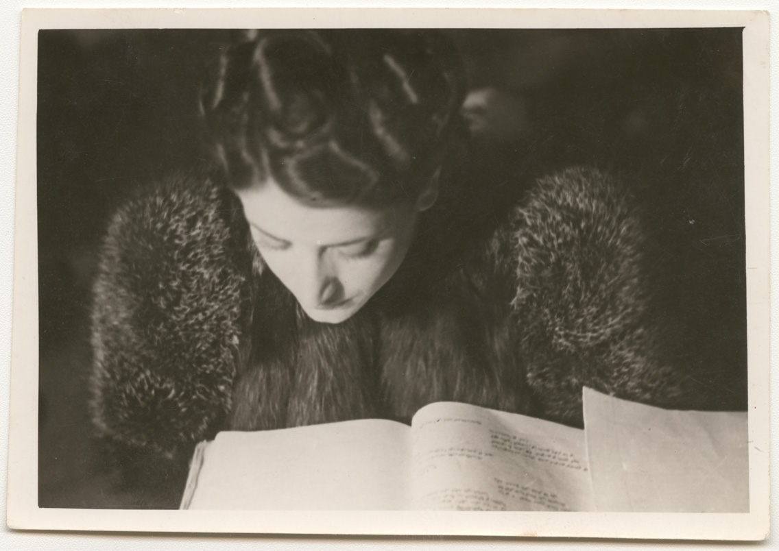Asmahan reading a script. Taken by an unidentified photographer between 1930 and 1945 in Egypt. Gelatin silver developing-out paper print, 6.6 x 9.4 cm. 0085at00010, 0085at – Faysal el Atrash collection, courtesy of the Arab Image Foundation, Beirut.