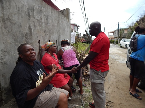 Grenada&#039;s Ambassador to the OECS H.E Dr. Patrick Antoine meets residents of Dominica as part of the relief mission to assist affected residents<br/><br/>Photo credit: Janeka Simon