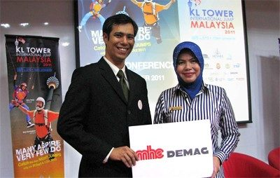 MHE-Demag service manager Kelvin Yeoh with Zuraidah Mohd Said, KL Tower's CEO at the sponsorship announcement.
