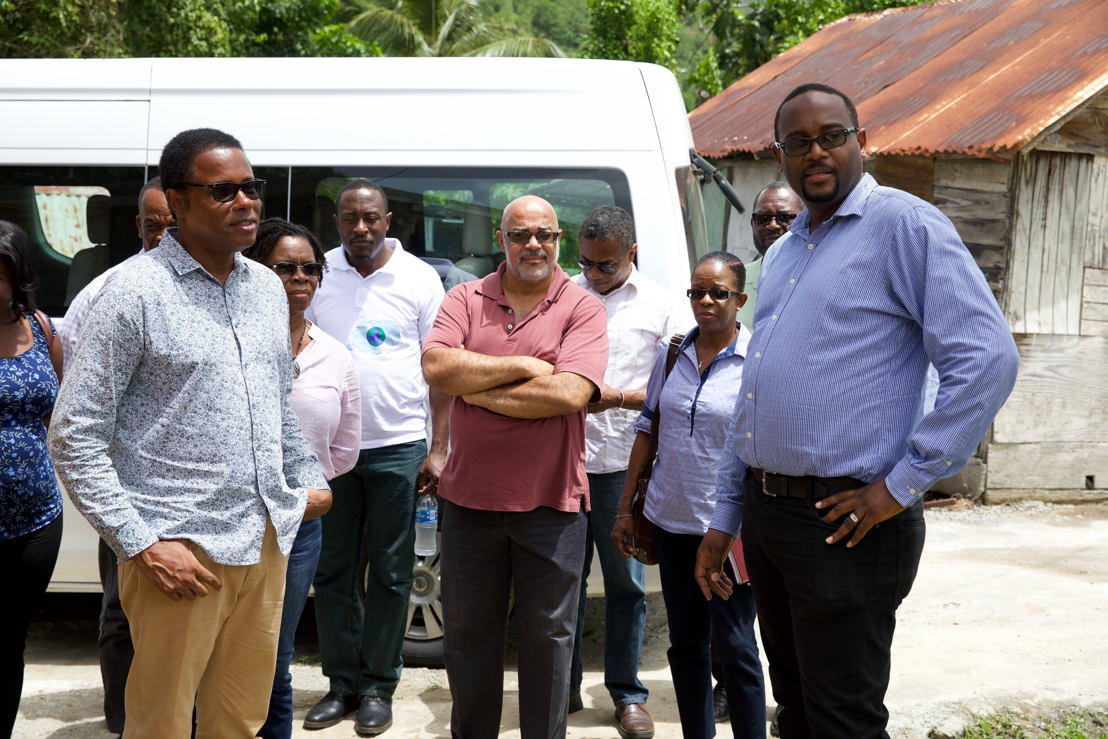 Minister Dean Jonas and OECS Director General Dr. Didacus Jules and a delegation inspect the innovative aquaponics facility.