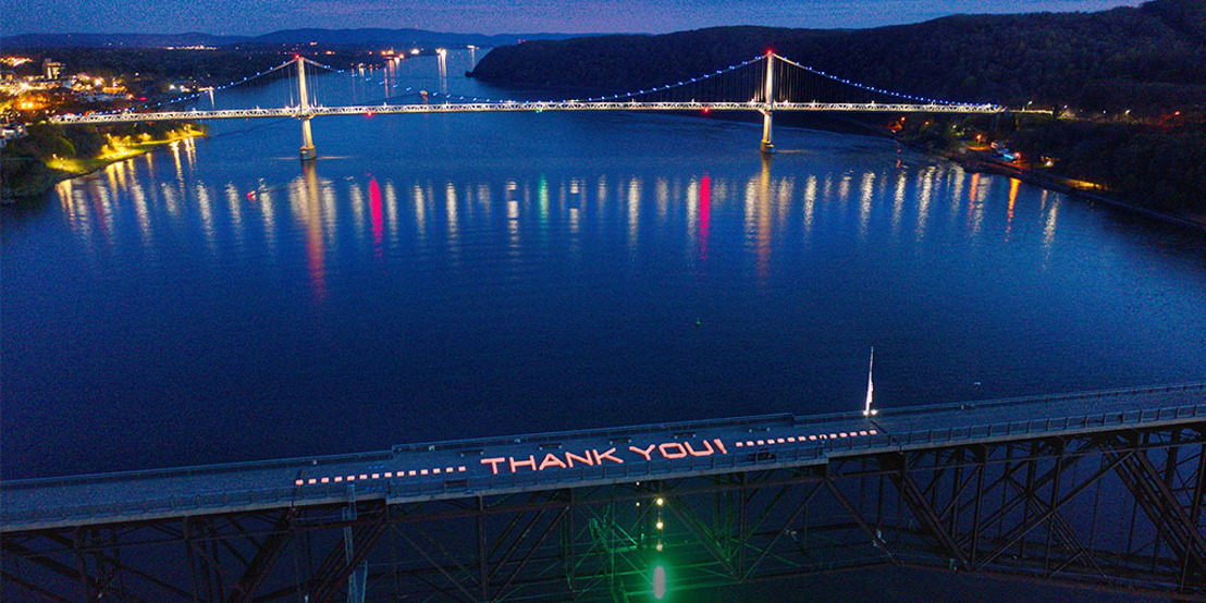 Walkway Over the Hudson State Historic Park Illuminated with 202-foot-long 'THANK YOU!' to Honor Frontline Workers During COVID-19 Pandemic