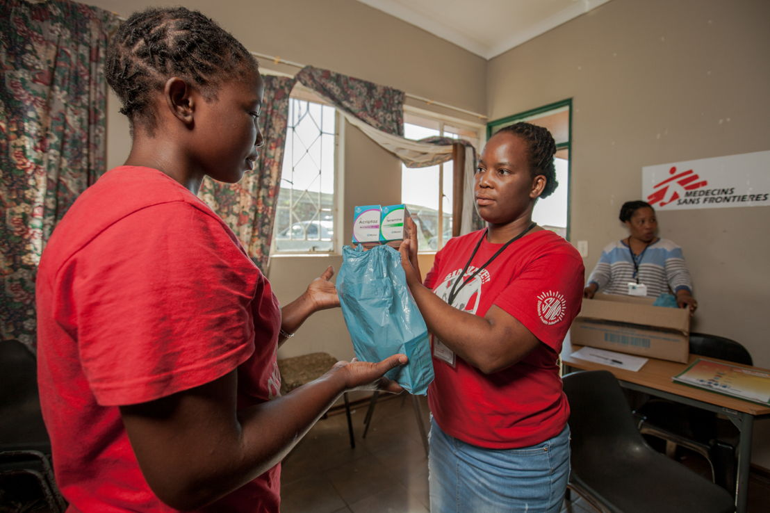 After having her blood pressure taken and her weight checked, 26-year-old Londiwe, a young mother, receives her 2-month supply of ARVs from Medecins Sans Frontieres (MSF) Lay Counsellor Gugulethu Mhlanga at the Community Adherence Club she's attending at King Dinizulu Clinic in Eshowe, KwaZulu-Natal. Londiwe is among 30 stable HIV+ patients who attend the club and now no longer have the hassle of sitting in long queues for 1-on-1 visits at the clinic, thereby reducing the strain on an already overburdened public health system. Photographer: Greg Lomas