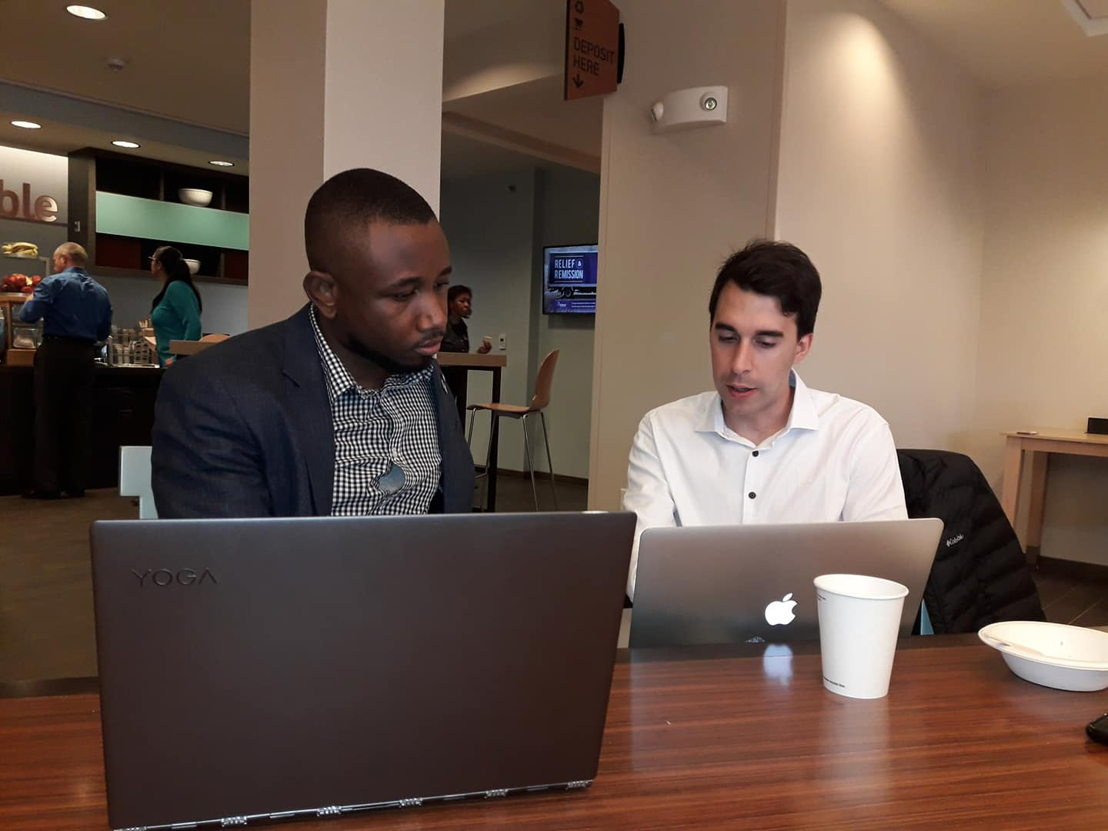 Shane Javed Browne works with a colleague to create a pitch at One Million Cups event.
