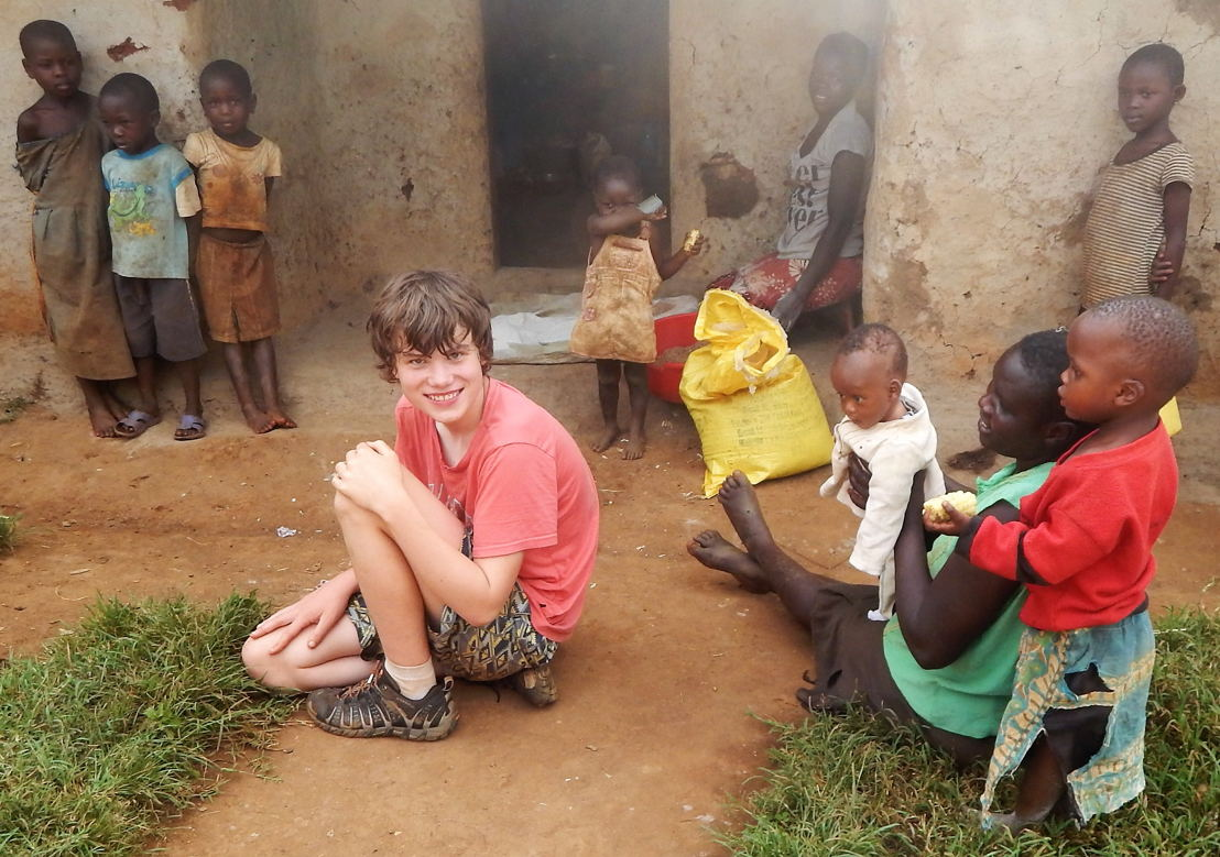 Sam Best with village kids. Australia Story