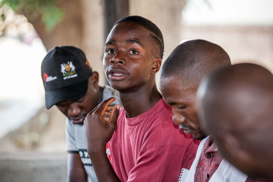 A peer educator shares his opinion in a group meeting. Photographer: Charmaine Chitate