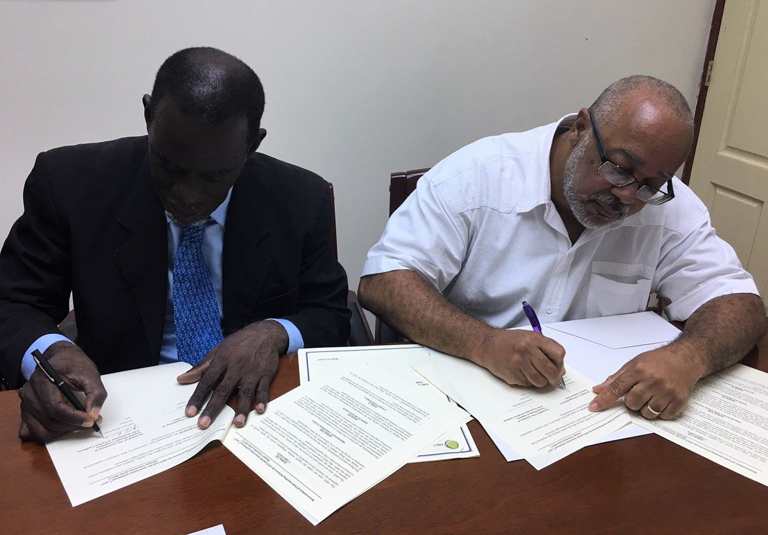 OECS Director General, Dr. Didacus Jules, and Mr. Alphonso Bridgewater, President of the ANOCES, complete MOU signing.