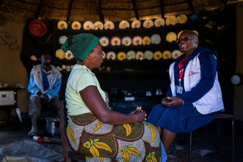 Beauty (36) and her husband Mr Chigouriemba (28) talk with MSF nurse mentor Sister Tendai about the possibility if having a child before having her uterus removed. © Melanie Wenger
