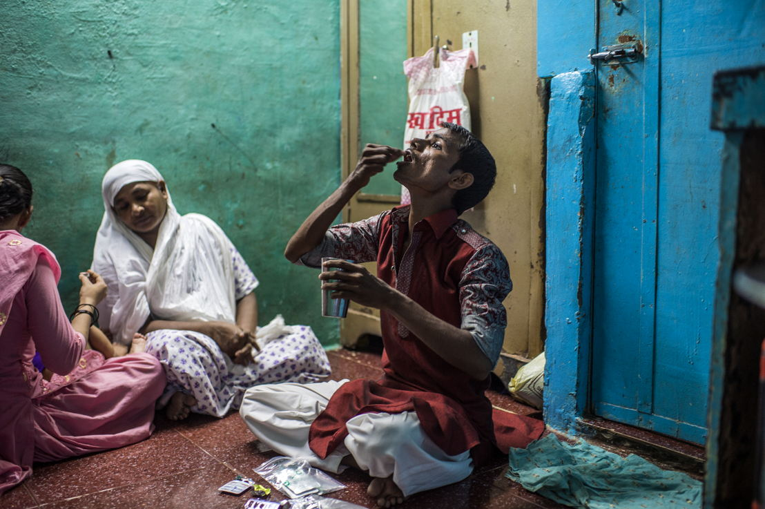 XDR-TB patient Hanif, taking his daily TB medication at home in the Govandi area of Mumbai.<br/><br/>Hanif is 25 years old, lives in Mumbai, and is one of only a handful of extensively drug-resistant TB (XDR-TB) patients in India lucky enough to be able to have acesss to the new drugs. After having failed treatment for the fourth time, Hanif was referred to the clinic of Medecins Sans Frontieres (MSF) / Doctors Without Borders, an international medical humanitarian organisation who since 2006 provides free diagnosis, treatment and support to patients with drug-resistant TB in Mumbai. Photographer: Atul Loke