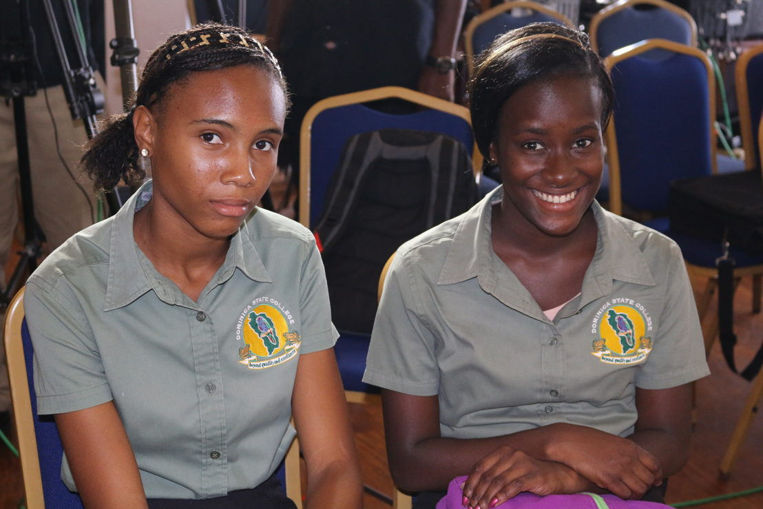Two students of the Dominica State College attend the Vini Koze Forum on Climate Change.