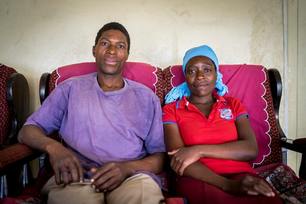 Portrait of Ngonidzashe (28) and her husband Hastings at home. They are a HIV positive couple supporting each other through ARV treatment, they also have 3 healthy children. © Melanie Wenger