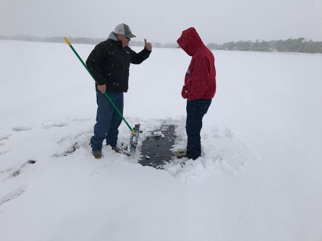 Proctor Produce's Matthew Proctor and Hirakata Farm's Michael Hirakata inspect a snowy cantaloupe field, April 2017