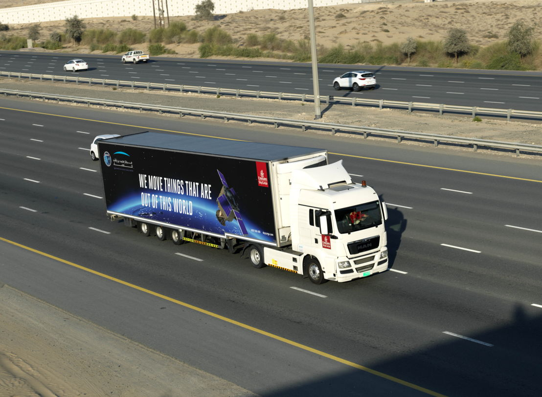 A specially branded Emirates SkyCargo truck transported KhalifaSat from MBRSC's facilities to Emirates SkyCentral DWC with a police escort