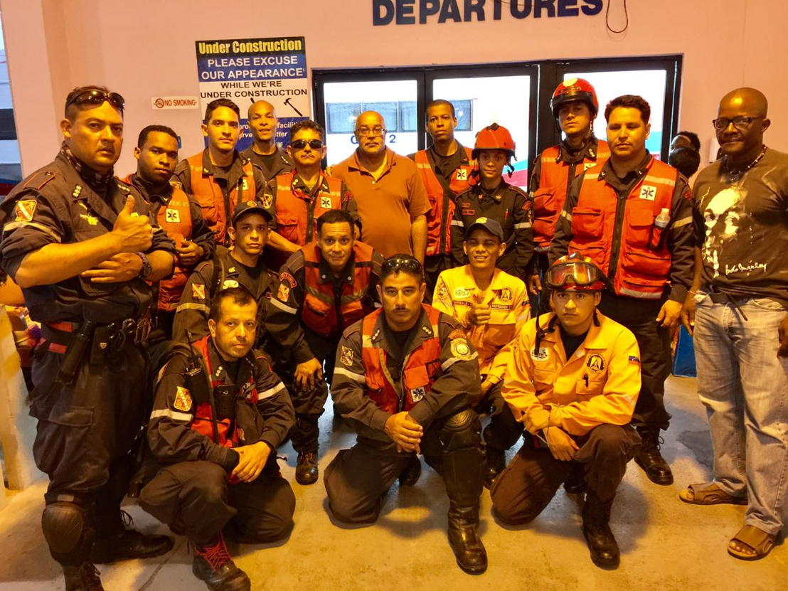 OECS Director General Dr. Didacus Jules meets with the Venezuelan Search and Rescue team prior to embarking on their life saving mission to Dominica
