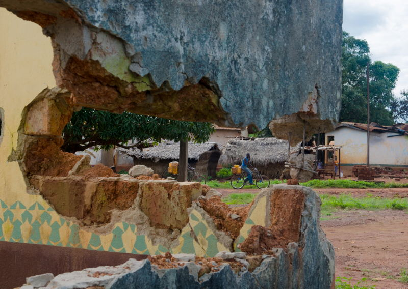 Bangassou street through the destroyed wall of the mosque. Photographer: Natacha Buhler