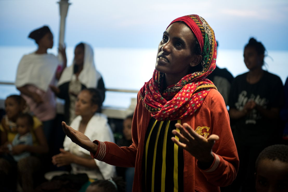 Credit: Gabriele François Casini / MSF<br/>Caption: Phoenix rescue 02 Sept 2015. An Eritrean woman singing a prayer with other women and children after being rescued 02 September 2015 by the MSF MY Phoenix search and rescue vessel at sea.