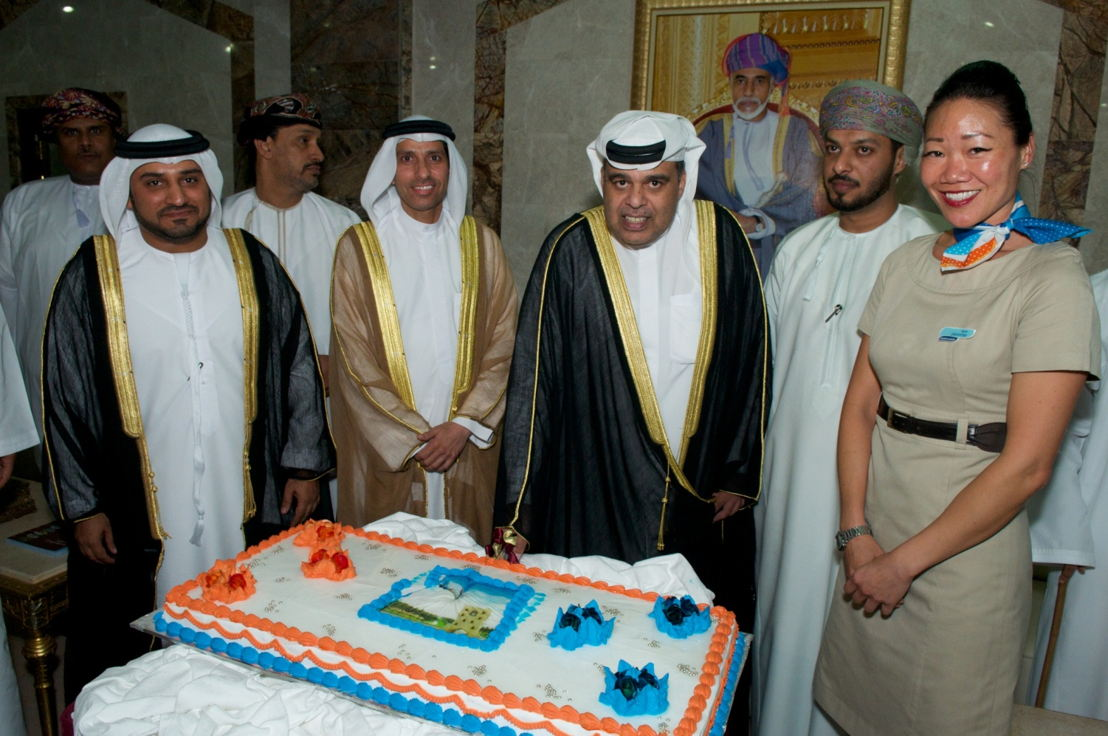 Mohamed Al Zarouni, Head of Air Transport at the Dubai Civil Aviation Authority and Omar Bin Ghaleb, Deputy Director General of the General Civil Aviation Authority join Hamad Obaidalla and Sheikh Hamood Bin Mustahil Al Mashani to cut the cake in celebration of flydubai's new route to Salalah