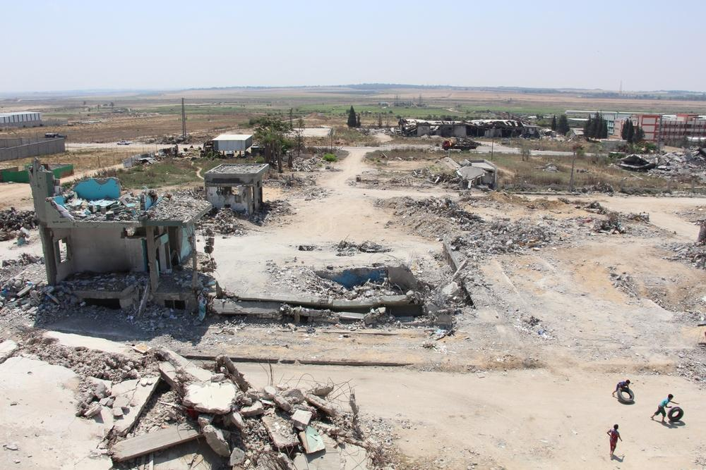 Shuja'iya, northeastern Gaza Strip, one of the hardest hit areas during 2014 summer war, remains of the almost completely destroyed Al-Wafa hospital during 2014 summer war, in the distance the Gaza Israel border. Photographer: Susanne Doettling/MSF