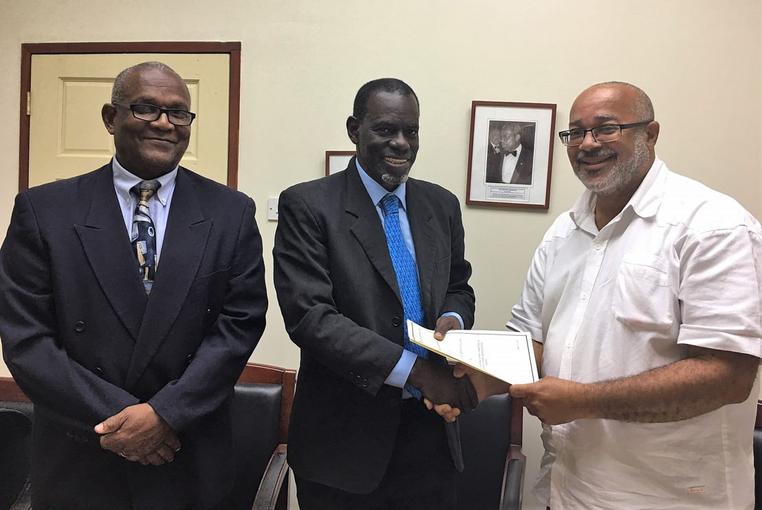 OECS Director General, Dr. Didacus Jules, and Mr. Alphonso Bridgewater, President of the ANOCES, complete MOU signing with Mr. Keith Joseph.