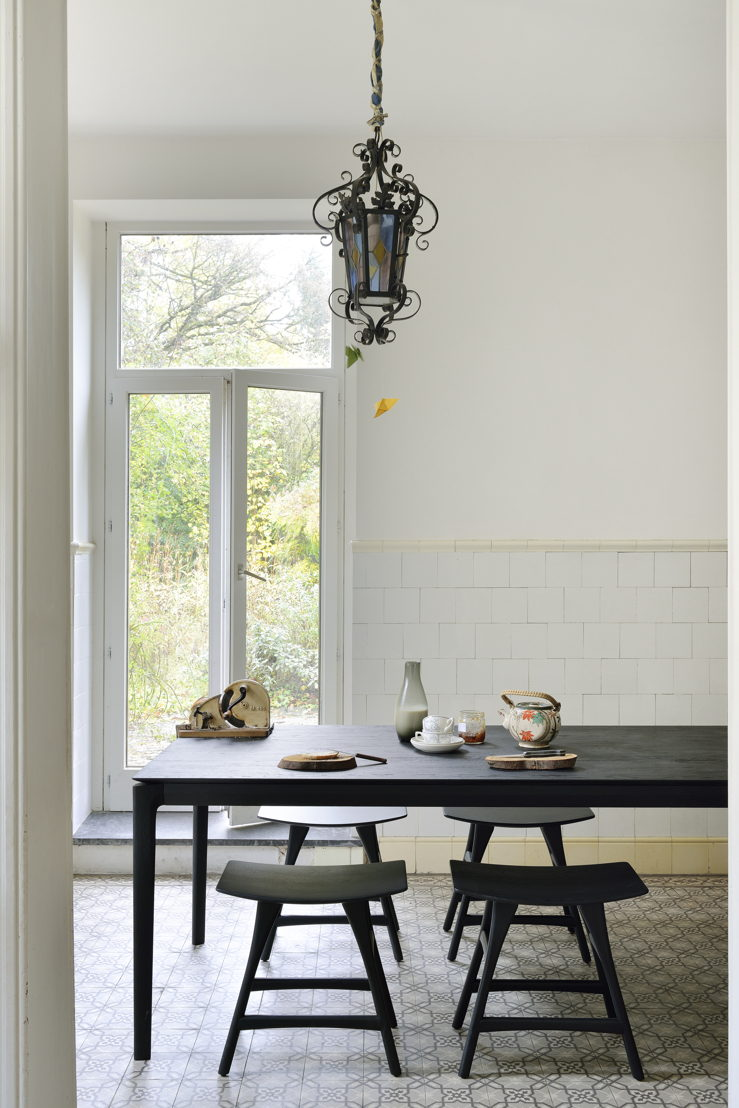 Ethnicraft Oak Bok dining table in black and Oak Osso stools in black
