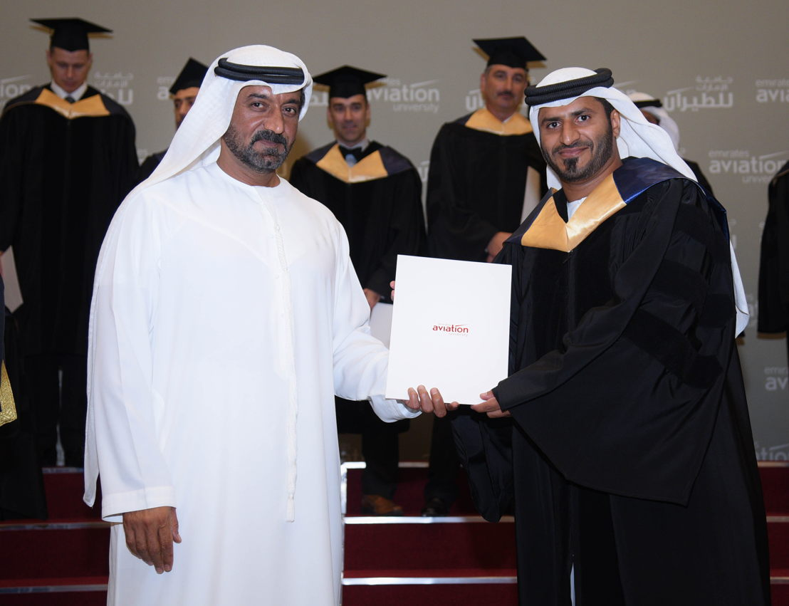 His Highness Sheikh Ahmed Bin Saeed Al Maktoum handing a diploma to one of the graduates.