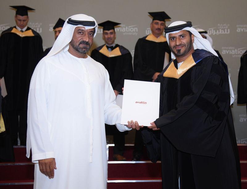 His Highness Sheikh Ahmed Bin Saeed Al Maktoum handing a diploma to one of the graduates.