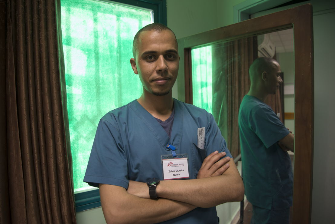 "Zaher Okasha, MSF nurse.<br/>""In just two months, we received more than 1,200 patients injured by gunshots in our clinics. MSF made great efforts to manage the emergency response. Surgical teams were deployed, donations of medicines were made, and here in the clinic we have been working hard to provide our patients with the best quality care. But with so many patients to treat, and the injuries so severe, MSF has recruited an extra 30 nurses to cope with the influx of wounded."" Photographer: Aurelie Baumel"