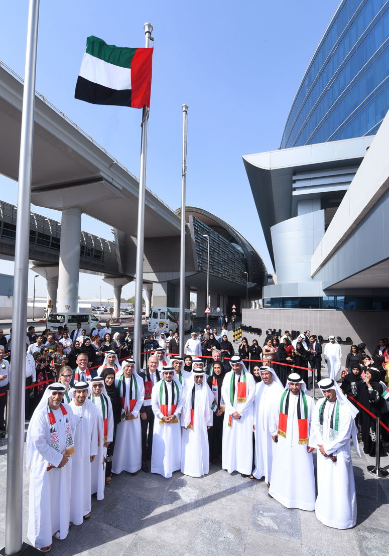 Sheikh Majid Al Mualla, Divisional Senior Vice President Commercial Operations, Centre for Emirates Airline hoisting the UAE Flag surrounded by senior management members in front of Emirates Group Headquarters.