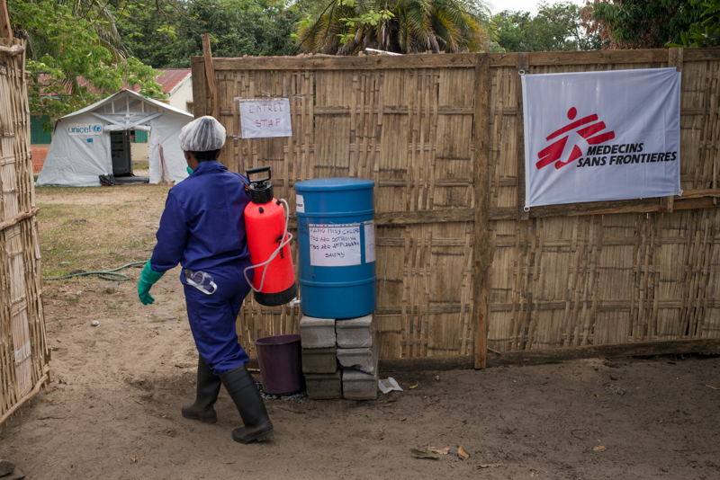 An employee of the Plague Triage and Treatment Center in charge of disinfection and sanitation enters the centre - Toamasina, Madagascar