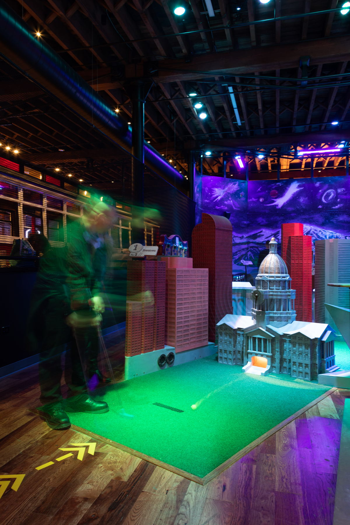 A player putts through the downtown Denver hole on one of Urban Putt's two, 9-hole courses. Photo credit: Jim Darling Photography